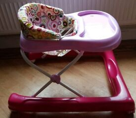 Pink baby walker with stoppers