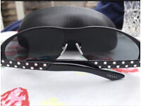 Genuine Prada Sunglasses, new, never worn!