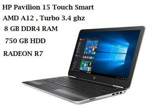 HP TouchSmart 15'' model AW017ca , AMD 10 cores A12-9700P, turbo 3.4 GHZ, 8GB 750GB, RADEON R7 + Mc Office PRO 2016