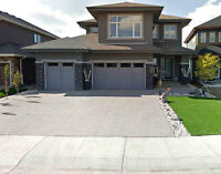 High Residence with Oversize Living Space and Three Car Garage.