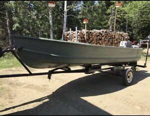 Boat with motors and trailer