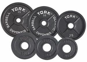 FITNESS EQUIPMENT IN CALGARY OLYMPIC WEIGHT PLATES DUMBBELLS