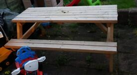Wooden bench/table, seats 6-8 people comes with parasol good condition