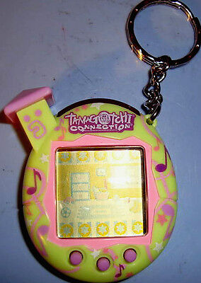 Last 1   Tamagotchi Connection  Key Chain Green   Pink Music Notes