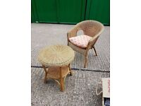 Rattan round side table and chair suitable for use in conservatory