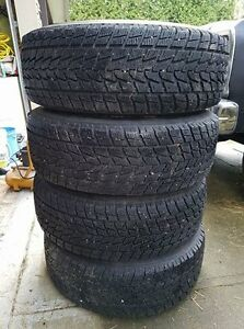 4 Toyo Open Country tires and rims