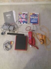 Nintendo Wii Mini Red with 2 Nunchucks, Sensor Bar and all wiring. Also 2 games