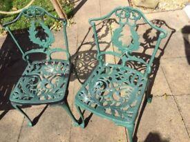 Matching pair Cast aluminium bistro garden chairs