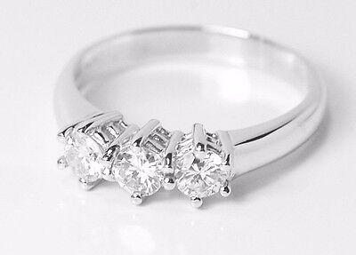trilogy anello in oro 18kt con brillanti naturali ct tot 015,trilogy diamanti