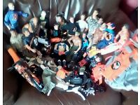 a large collection of action men some vintage with action man bike and husky and various other bits.