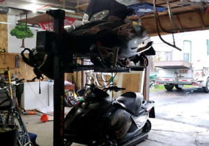 Two sleds and a lift for sale or trade for side by side