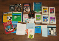 Lot of vintage TI-99 games, controllers, & manuals