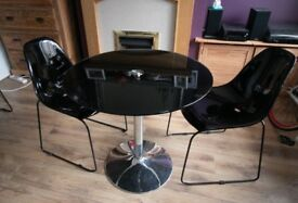 Dining room table. Black glass, two chairs.