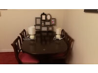 JOBLOT - Extending wooden dining table with 4 chairs. 2 lamps and a picture frame