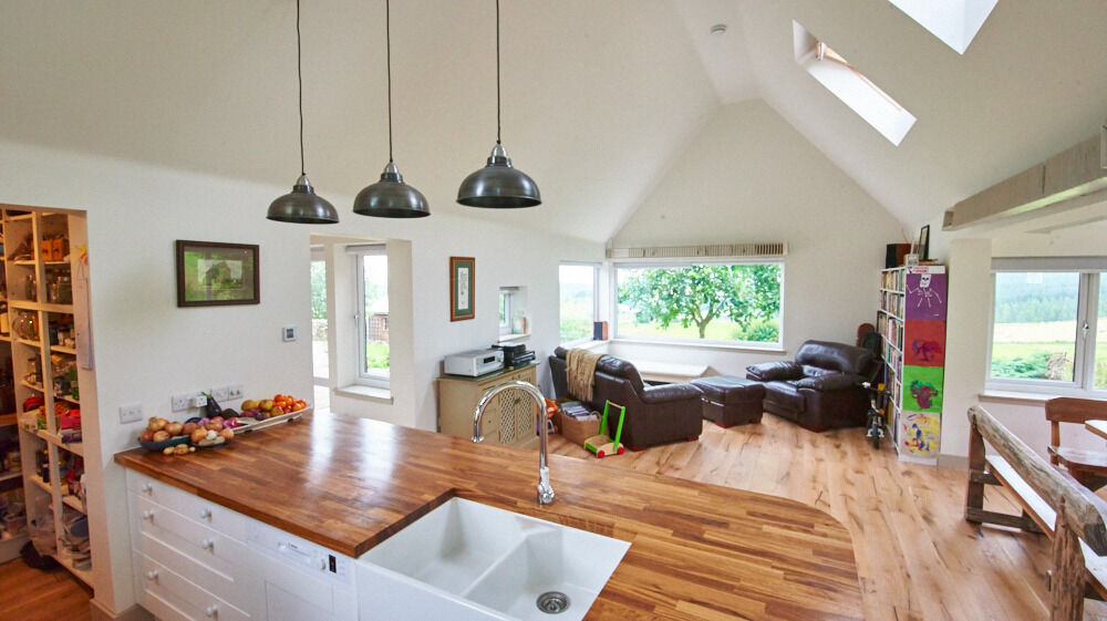 rural scottish country cottage with cathedral ceiling extension and
