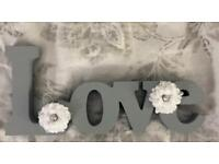 Hand decorated love signs
