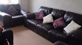 Black Comfortable three seater sofa settee with two chairs plus foot stall For sale