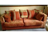 Duck feathered very large orange sofas