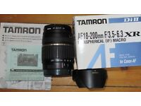 Tamron 18-200mm zoom lens fits Canon DLSRs. With lens hood and UV filter.