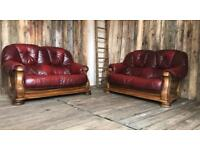 Pair of leather oxblood Italian leather dfs sofas