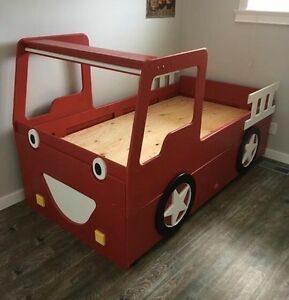 Handcrafted fire truck trundle bed