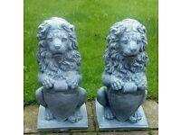 Two pairs of concrete lion garden ornaments