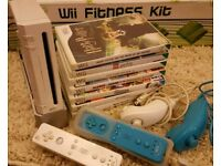 Wii with fit board and controllers