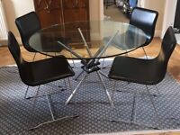 Angel by Frag 4 chairs and round glass dining table