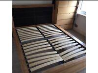 Free oak bedframe with leather headboard.