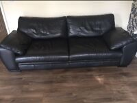 Black leather sofa with swivel chair