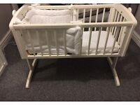 White wooden crib with matress