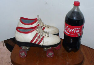 1960/70's wight and red  classic classic rollerskates.Coca-Cola