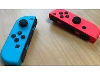 Official Nintendo Joy-Con Pair - Neon Red/Neon Blue (Nintendo Switch)