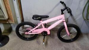 Vélo pour enfant rose 1 vitesse roues 16po