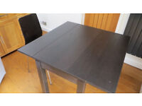 Black Extendable Table and Two Chairs