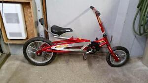 Vélo quetzal rouge pour enfant 1 vitesse roues 16po avant 20po arrière