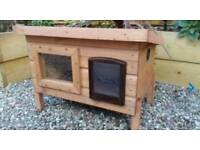 Outdoor cat house with cat flap