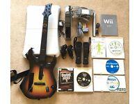Nintendo Wii bundle (console, controllers, nunchucks, balance board, guitar & games)
