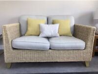 Marks and Spencer rattan sofa reupholstered with Laura Ashley fabric