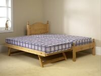Pine single bed with trundle under bed complete with mattresses