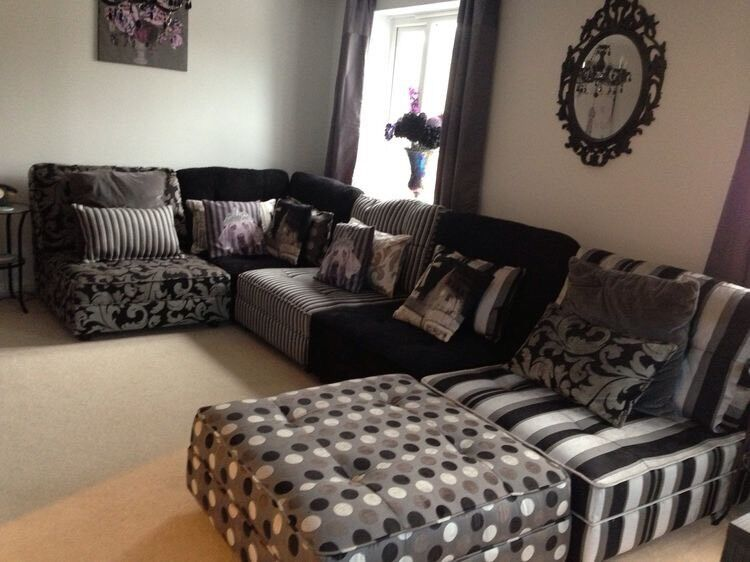 Module DFS sofain Gorseinon, SwanseaGumtree - Lovely unusual sofa, fabric module style. Each unit is individual and can be moved around to your desired sofa shape. Colours black and grey. Sofa wont be ready to collect for 2 weeks. This cost £4000 new. Any questions please ask