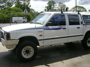 WRECKING FORD COURIER UTE DUAL CAB 2.6 MANUAL PARTS ONLY $1 WHEEL NUT
