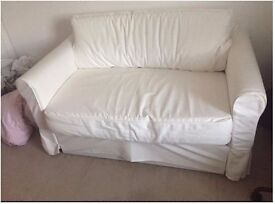 White rolling sofa bed