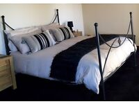 Kingsize cast iron bedframe with mattress