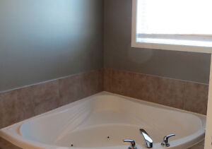 Corner Jacuzzi Tub with taps - pick-up in Camrose