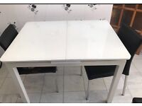 White glass extending table and 6 chairs
