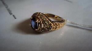 1.52 carat topaz & tourmaline ring,valued $2850 for quad,boat...
