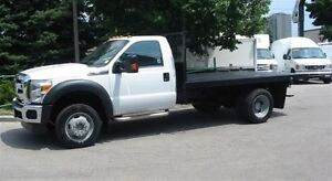 2014 Ford F-550 4x4 gas chassis with flat deck