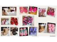 Mix of different pairs of toddler shoes and boots