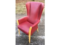 Red wing backed armchair. £40.